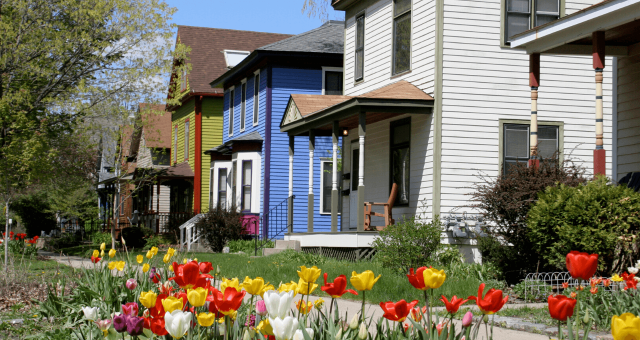 Row of houses with colorful flowers